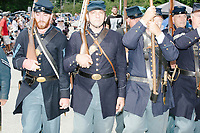 Men carrying rifles and wearing Civil War Union uniforms march in the 4th of July parade in Amherst, New Hampshire, on Thu., July 4, 2019.