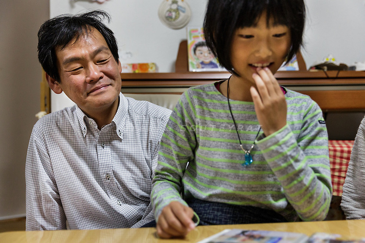 Kyoto, Japan, November 27 2016 - At home with Mr KWAK Jinwoong and his family. All members were born in Japan. Mr KWAK has South-Korean nationality and a passport, while his wife JONG Myong Ae, 46, kept the &laquo;&nbsp;chosen&nbsp;&raquo; japanese status which means she technically has no valid passport and a lot of difficulties to travel. She owns 2 documents: a 2 year temporary passport issued by DPRK authorities when she traveled to Pyiongyang at the age of the 18 and a &laquo;&nbsp;travel certificate&nbsp;&raquo; issued by South Korea with no international validity. Their kids, Myong (daughter, 9) and Chi-chyon (son, 6), will have to choose their nationality when they turn 20.<br /> The majority of Koreans in Japan are Zainichi Koreans, often known simply as Zainichi , who are the permanent ethnic Korean residents of Japan. The term &quot;Zainichi Korean&quot; refers only to long-term Korean residents of Japan who trace their roots to Korea under Japanese rule, distinguishing them from the later wave of Korean migrants who came mostly in the 1980s. The estimated population is about 500,000 people. As of 2016, about 90% of them have South Korean nationality and 10% of them are considered by Japanese administration as &laquo;&nbsp;Korean&nbsp;&raquo; (chosenjin), the word used for korean people before the division between North and South Korea in 1948. The ratio used to be the opposite in the 1950ies.