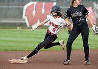 Sun Prairie's Grace Radlund rounds second base in the bottom of the first inning in front of Oshkosh North's Brooke Ellestad in the championship game of the 2019 Division 1 Wisconsin WIAA girls state high school softball tournament on June 8 at Goodman Diamond in Madison, Wisconsin