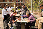 New York City, New York: Chess players in Washingston Square in Greenwich Village  .Photo #: ny310-15146  .Photo copyright Lee Foster, www.fostertravel.com, lee@fostertravel.com, 510-549-2202.