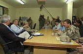 United States Secretary of Defense Donald H. Rumsfeld (2nd from left) meets with local and military Iraqi leaders in Kirkuk, Iraq, on October 10, 2004.  Rumsfeld is in Iraq to meet with Iraqi officials and coalition troops deployed there. <br /> Mandatory Credit: James M. Bowman / DoD via CNP