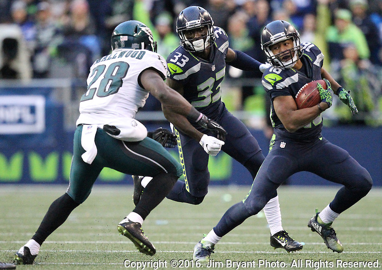 Seattle Seahawks wide receiver Tyler Lockett (16) looks for running room against Philadelphia Eagles running back Wendell Smallwood (28) on a punt return<br /> at CenturyLink Field in Seattle, Washington on November 20, 2016.  Seahawks beat the Eagles 26-15.  &copy;2016. Jim Bryant Photo. All Rights Reserved.