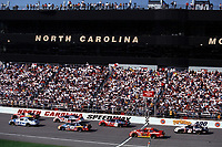 The field races part the grandstand during the Pop Secret 400 at Rockingham, NC in October 2000.(Photo by Brian Cleary)