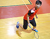 Salvatore Lo of Syosset goes to return a volley from Great Neck South's Ray Ngan (not pictured) during a first singles varsity boys badminton match at Syosset High School on Thursday, Oct. 6, 2016.