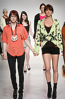 Senior fashion designer Hannah Peyser, walks runway with model, at the close of the Pratt 2011 fashion show.
