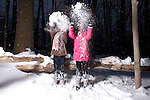 Twin Sisters Playing in Fresh Snow