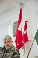 "Switzerland. Canton Ticino. Rivera. Colonel Nicola Guerini is the commanding officer of Monte Ceneri military base. He is also the military chief of the Special Forces Command (German: Kommando Spezialkräfte), an infantry corps of the Swiss Armed Forces specialised in rapid offensive operations, intel gathering and operations in urban areas, open fields and other difficult terrains, capable of acting on short notice. In his office, the professional soldier seats close to Swiss and Special Forces Command flags. Due to the spread of the coronavirus (also called Covid-19), the Federal Council has categorised the situation in the country as ""extraordinary"". The army was called upon to provide logistical support and to offer its skills in terms of medical assistance (ambulances, field hospital, tents, nurses,..). The militia soldiers from medical troops were called by the Swiss army for the first time since World War II. Under the country's militia system, professional soldiers constitute a small part of the military and the rest are conscripts or volunteers aged 19 to 34 (in some cases up to 50). Monte Ceneri is a mountain pass in the canton of Ticino. It connects the Magadino plain and the Vedeggio valley across the Prealps. 2.04.2020 © 2020 Didier Ruef"