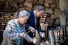 September 12, 2018; Ban Ki-moon, former secretary-general of the United Nations and his wife Madam Soon-taek Yoo light candles at the Grotto during their visit to campus for the Liu Institute Asia Leadership Forum. (Photo by Matt Cashore/University of Notre Dame)