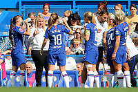 Chelsea Women's Manager, Emma Hayes chats with her players while there is a break in the play during Chelsea Women vs Tottenham Hotspur Women, Barclays FA Women's Super League Football at Stamford Bridge on 8th September 2019