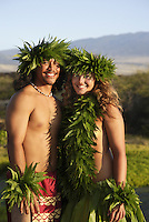 Kane (male) and wahine (female) hula dancers wearing palapalai fern head lei, headshot.