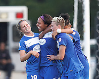 Boston Breakers forward Sydney Leroux (2) celebrates her goal with teammates.  In a National Women's Soccer League (NWSL) match, Boston Breakers (blue) defeated Sky Blue FC (white), 3-2, at Dilboy Stadium on June 30, 2013.