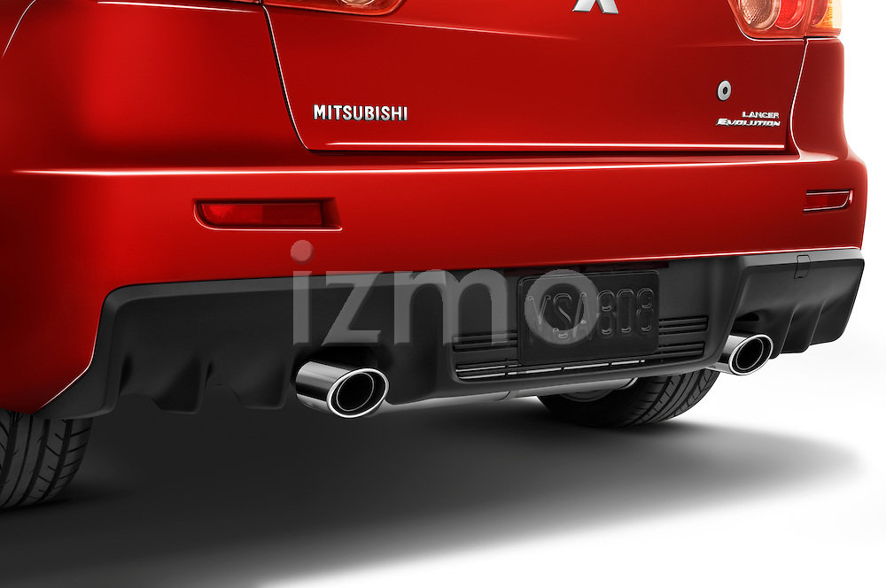 Detail of dual exhaust chrome tips from a 2008 Mitsubishi Lancer Evolution