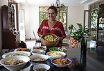 6 DECEMBER, 2019 BALI, INDONESIA:  Author and organiser of the Ubud Food Festival and Ubud Writers Festival, Janet De Neefe with an Indonesian feast at her home in Ubud, Bali. There has been a levelling out of Australian tourist numbers to Bali in recent times and tastes are changing regarding what people want from their holiday. Millennials are being targeted by tourism authorities and they want to give them more boutique experiences than just beach and beer. Picture by Graham Crouch/The Australian