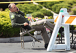 Carson City Sheriff Ken Furlong talks on his phone outside the IHOP restaurant in Carson City, Nev., on Wednesday, Sept. 7, 2011. The investigation continues into Tuesday's shooting that left five dead and seven injured. (AP Photo/Cathleen Allison)
