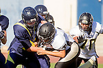 Santa Monica, CA 10/17/13 - unidentified Peninsula player(s) in action during the Peninsula vs Santa Monica Junior Varsity football game at Santa Monica High School.