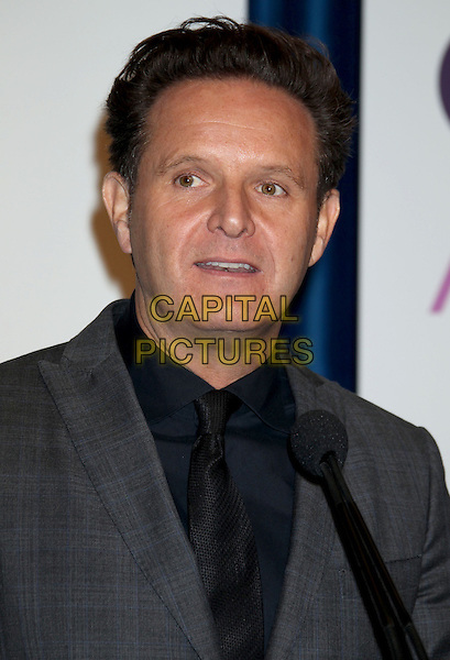 Mark Burnett.2013 People's Choice Awards Nominations held at The Paley Center, Beverly Hills, California, USA, .15th November 2012 .portrait headshot  grey gray black shirt tie microphone .CAP/ADM/RE.©Russ Elliot/AdMedia/Capital Pictures.