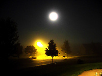 Moonlight shines down on a foggy suburban street in DeForest, Wisconsin.