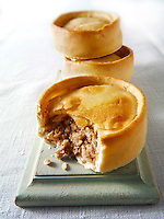 Scotch pies. One open to show filling
