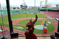 Boston, MA - Carlos Lemus of Fish Company  cleans the window of the owner's box as workers put the finishing touches on Fenway Park for the Red Sox 2012 home opener. Thursday, April 12, 2012.