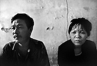 An HIV-positive married couple in Haiphong, Vietnam on October 22, 2000. Nguyen Van Minh is a heroin addict and has infected his wife Thi Le, who does not use drugs. The two still live together, and are trying to help other AIDS victims cope.  Worldwide, more than 20 million people have died since the first cases of AIDS were identified in 1981.