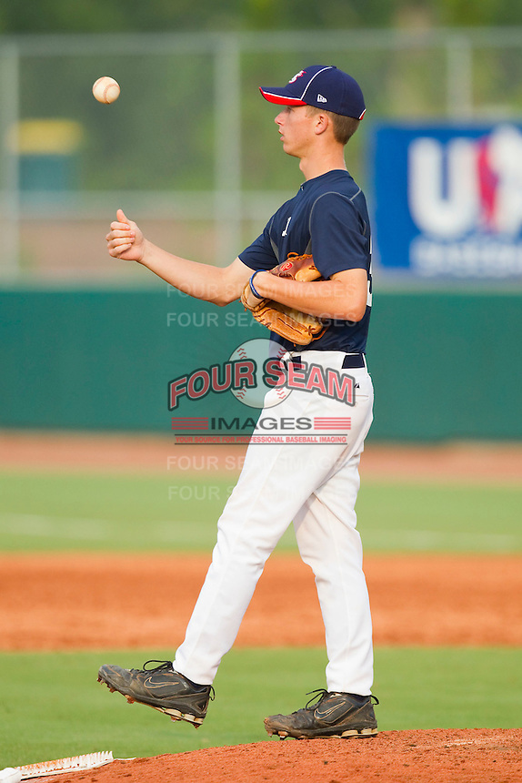 Kyle Smith #33 of Team Blue flips the ball in the air while waiting for the next batter against Team Red during the USA Baseball 18U National Team Trials at the USA Baseball National Training Center on June 30, 2010, in Cary, North Carolina.  Photo by Brian Westerholt / Four Seam Images