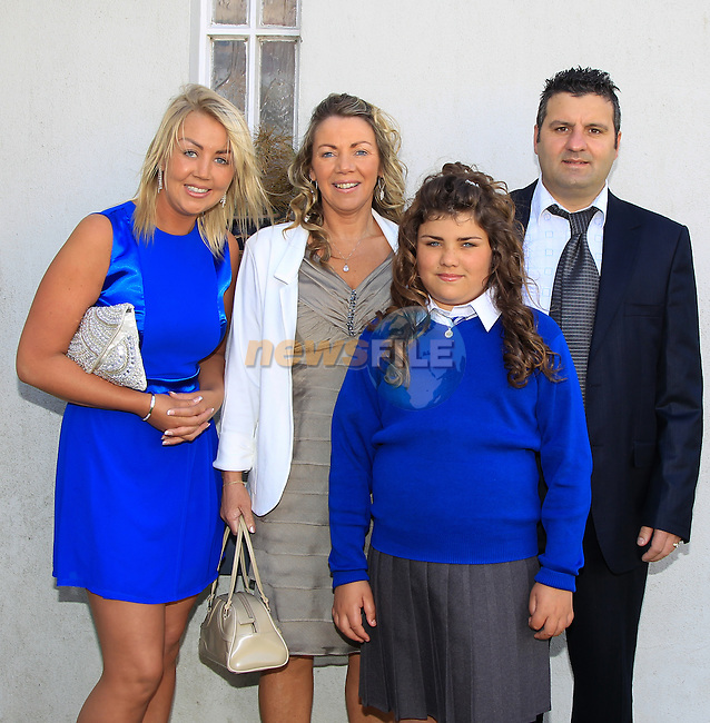 Natasha Corcoran with sponsor Amanda and Carmel and Roberto Corcoran during Confirmation at St. Joseph's Church in Mell, Drogheda on Monday 11th May 2015.<br /> Picture:  Thos Caffrey / www.newsfile.ie