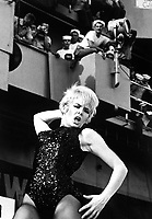 "Watusi, Frug, Shimmy, Twist!  On a carrier? - It's swinging time on board Ticonderoga as Miss Joey Heatherton rocks out with a ""Tico Tiger"" during the Bob Hope Show.  (USIA)<br /> NARA FILE #:  306-MVP-8-6<br /> WAR & CONFLICT BOOK #:  391"