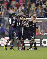 New England Revolution midfielder Shalrie Joseph (21), New England Revolution forward Kheli Dube (11), New England Revolution forward Zack Schilawski (15), and New England Revolution defender Seth Sinovic (27) celebrate New England Revolution's second goal. The New England Revolution defeated the New York Red Bulls, 3-2, at Gillette Stadium on May 29, 2010.