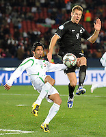 Shane Smeltz of New Zealand and Mohammed Ali Kareem of Iraq. Iraq and New Zealand tied 0-0 during the FIFA Confederations Cup at Ellis Park Stadium in Johannesburg, South Africa on June 20, 2009..