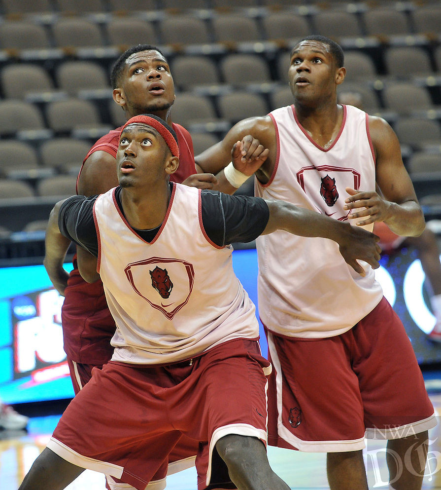 NWA Democrat-Gazette/Michael Woods --03/15/2015--w@NWAMICHAELW... University of Arkansas players Bobby Portis (front) Trey Thompson and Manuael Watkins run drills Wednesday evening during their practice at Jacksonville Veterans Memorial Arena in Jacksonville, Florida.