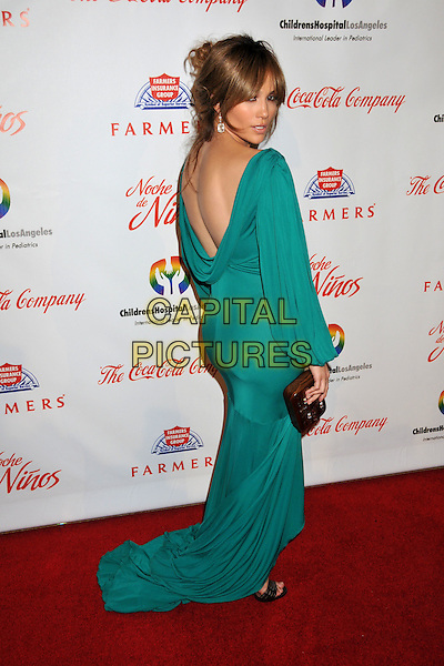 "JENNIFER LOPEZ.3rd Annual ""Noche De Niños"" Gala Benefit for the Children's Hospital of Los Angeles held at the Beverly Hilton Hotel,  Beverly Hills, CA, USA..May 9th, 2009.full length green dress gold clutch bag slit split ruched slit split fishtail looking over shoulder train backless .CAP/ADM/BP.©Byron Purvis/AdMedia/Capital Pictures."