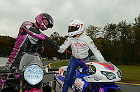 Oct. 8, 2012; Mohnton, PA, USA: NHRA pro stock motorcycle rider Hector Arana Jr (right) congratulates Eddie Krawiec during the Auto Plus Nationals at Maple Grove Raceway. Mandatory Credit: Mark J. Rebilas-