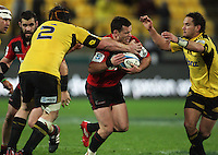 Ryan Crotty tries to break through Andrew Hore and Aaron Cruden. Super 15 rugby match - Crusaders v Hurricanes at Westpac Stadium, Wellington, New Zealand on Saturday, 18 June 2011. Photo: Dave Lintott / lintottphoto.co.nz