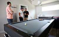 NWA Democrat-Gazette/DAVID GOTTSCHALK  Kyle Pumphrey (from left), Ryan Quattrocchi (cq), and Sam Crider, all students at the University of Arkansas in Fayetteville, visit on the second level of their furnished four bedroom at Beechwood Village Wednesday, August 26, 2015 in Fayetteville. The students are living in a Draper, one of 12 different floor plans.