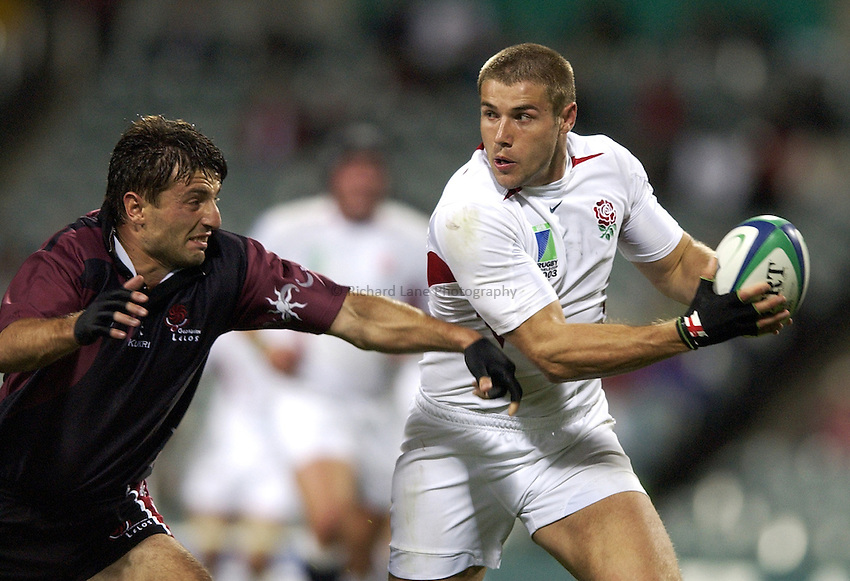 Photo: Richard Lane..England v Georgia, Pool C at the Subiaco Oval, Perth. RWC 2003. 12/10/2003. .Ben Cohen attacks as Malkhaz Urjukashvili attempts to tackle.