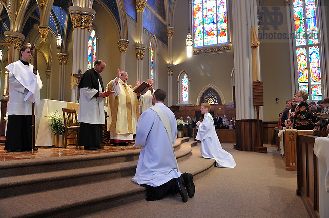 Bishop Daniel Jenky, C.S.C. prays over Rev. Gerry Olinger, C.S.C. (left) and Rev. Kevin Grove, C.S.C. during their ordination in the Basilica of the Sacred Heart April 10, 2010...Photo by Matt Cashore/University of Notre Dame