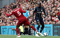 Manchester City's Benjamin Mendy under pressure from Liverpool's Georginio Wijnaldum<br /> <br /> Photographer Rich Linley/CameraSport<br /> <br /> The Premier League - Liverpool v Manchester City - Sunday 7th October 2018 - Anfield - Liverpool<br /> <br /> World Copyright &copy; 2018 CameraSport. All rights reserved. 43 Linden Ave. Countesthorpe. Leicester. England. LE8 5PG - Tel: +44 (0) 116 277 4147 - admin@camerasport.com - www.camerasport.com