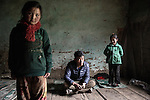 Sonam Dorji , 31 years with his daughters, they live in Dango Chang village at 4100 metri<br /> &nbsp;28 Houses and 300 people live here. Jhomolhari, Bhutan June 2016