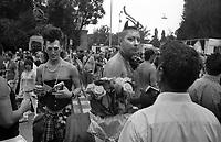 milano, gay pride parade. venditore di rose --- milan, gay pride parade. seller of roses