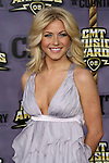 Julianne Hough arrives on the purple carpet prior to the Country Music Television Music Award show at the Curb Event Center in Nashville,Tennessee on April 14,2008.