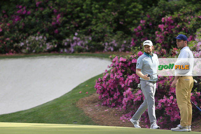 Tyrrell Hatton (ENG) and Francesco Molinari (ITA) on the 13th green during the 1st round at the The Masters , Augusta National, Augusta, Georgia, USA. 11/04/2019.<br /> Picture Fran Caffrey / Golffile.ie<br /> <br /> All photo usage must carry mandatory copyright credit (© Golffile | Fran Caffrey)