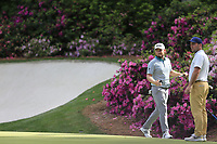 Tyrrell Hatton (ENG) and Francesco Molinari (ITA) on the 13th green during the 1st round at the The Masters , Augusta National, Augusta, Georgia, USA. 11/04/2019.<br /> Picture Fran Caffrey / Golffile.ie<br /> <br /> All photo usage must carry mandatory copyright credit (&copy; Golffile | Fran Caffrey)