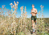 Triathlete Clifford Drusinsky (cq) trains near his home in Westminster, Colorado, Friday, September 19, 2014. Drusinsky, who owns a training gym, uses and promotes edible marijuana to help with endurance and recovery.<br /> <br /> Photo by Matt Nager