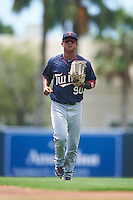 GCL Twins left fielder Lean Marrero (90) jogs to the dugout during a game against the GCL Orioles on August 11, 2016 at the Ed Smith Stadium in Sarasota, Florida.  GCL Twins defeated GCL Orioles 4-3.  (Mike Janes/Four Seam Images)