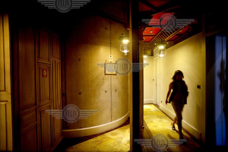 A guest walks along a corridor in the Hotel DO Placa Reial. /Felix Features
