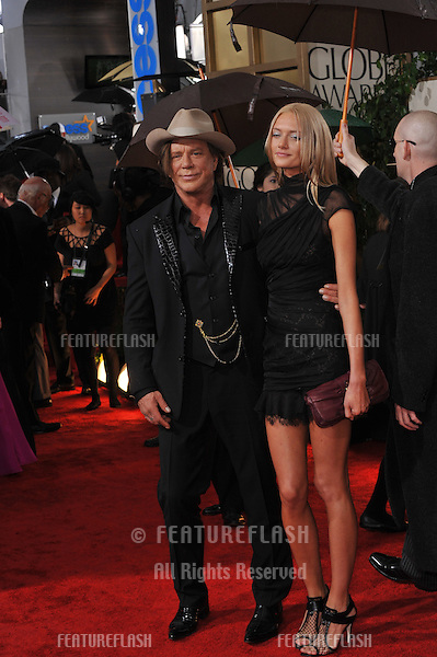 Mickey Rourke & date at the 67th Golden Globe Awards at the Beverly Hilton Hotel..January 17, 2010  Beverly Hills, CA.Picture: Paul Smith / Featureflash