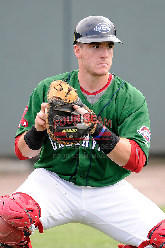 Catcher Jordan Procyshen (29) of the Greenville Drive warms up before a game against the Savannah Sand Gnats on Sunday, August 24, 2014, at Fluor Field at the West End in Greenville, South Carolina. Greenville won, 8-5. (Tom Priddy/Four Seam Images)
