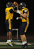 Xavier Arline #7, Shoreham-Wading River quarterback, left, gets congratulated by teammate James Mirabell #89 after running for a touchdown of approximately 35 yards in the first quarter of a Suffolk County Division IV varsity football game against Babylon at Shoreham-Wading River High School on Friday, Oct. 20, 2017.