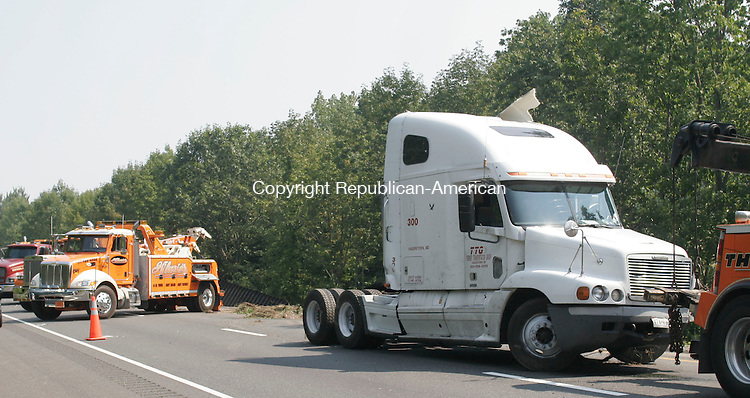 SOUTHBURY, CT - 09 SEPTEMBER 2006 - 090906JW03.jpg -- A tractor waits to be towed after being involved in an accident with a  Connecticut State Police car that closed the two lanes of I84 westbound between exits 16 and 15 Saturday. Jonathan Wilcox Republican-American