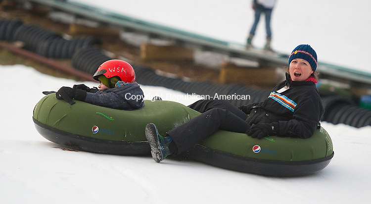 WOODBURY, CT-122513JS01- Randi Shane and her son Cole Kerstein, 4, both of New Rochelle, NY, enjoyed an afternoon snow tubing at Woodbury Ski Area in Woodbury on Wednesday. <br /> Jim Shannon Republican-American